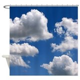 Puffy clouds Shower Curtains