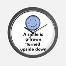 A smile is a frown turned ups Wall Clock