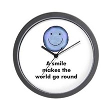 A smile makes the world go ro Wall Clock