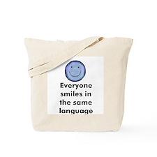 Everyone smiles in the same l Tote Bag