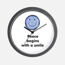Peace begins with a smile Wall Clock