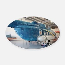 Helicopter in servicing hangar - Oval Car Magnet