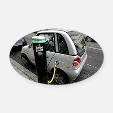 Recharging an electric car - Oval Car Magnet