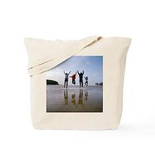 Family at a beach - Tote Bag