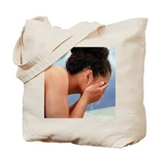 Woman rinsing her face - Tote Bag