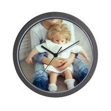 Girl holding doll - Wall Clock