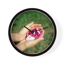 Flower held in hands - Wall Clock