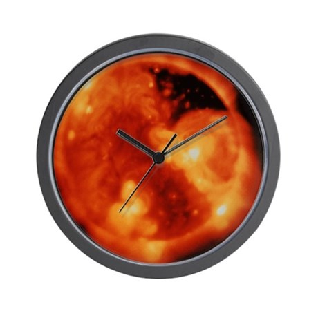 x ray image of sun   wall clock by sciencephotos