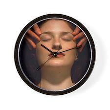 Woman receives a facial massage - Wall Clock