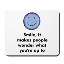 Smile, it makes people wonder Mousepad