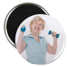 Senior woman lifting weights - Magnet