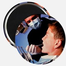 Dentist examining a boy's mouth - Magnet