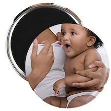 Baby taking medicine - 2.25