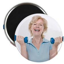 Senior woman lifting weights - 2.25