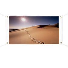 Footprints over sand dunes - Banner