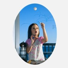 Girl drawing - Oval Ornament