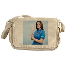 Nurse pulling on a glove - Messenger Bag