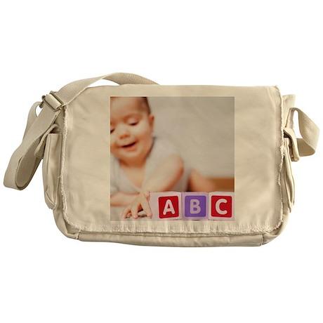 Baby boy playing - Messenger Bag