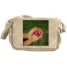 Flower held in hands - Messenger Bag