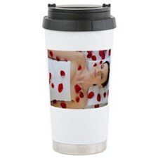 Woman covered in flower petals  Travel Mug