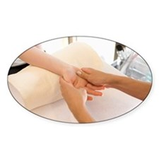 Young woman massaging hands Decal