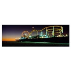 Rollercoaster And Ferris Wheel At Dusk On The Sant Framed Print