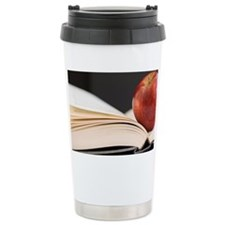 Close up of open book and apple Travel Mug