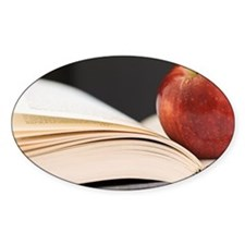 Close up of open book and apple Decal