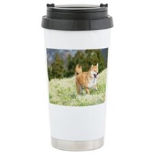 Dog running on hill Travel Mug