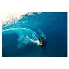 Man surfing in the sea Framed Print