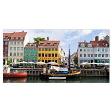 Buildings along a canal with boats, Nyhavn, Copenh Poster