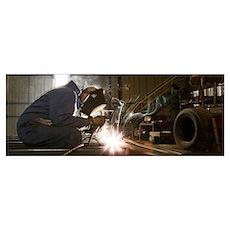 Man welding in a workshop Poster