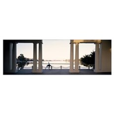 Person stretching near colonnade, Lake Merritt, Oa Canvas Art