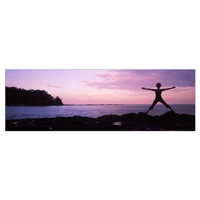 Rear view of a woman exercising on the coast, La P Framed Print