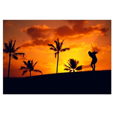 Silhouetted Golfer In Dramatic Orange Sunset Sky Framed Print