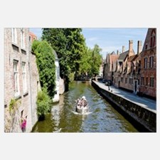 Tourboat in a canal, Bruges, West Flanders, Belgiu