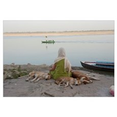 Woman meditating at the riverbank, Ganges River, V Framed Print