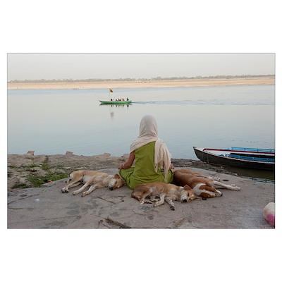 Woman meditating at the riverbank, Ganges River, V Poster