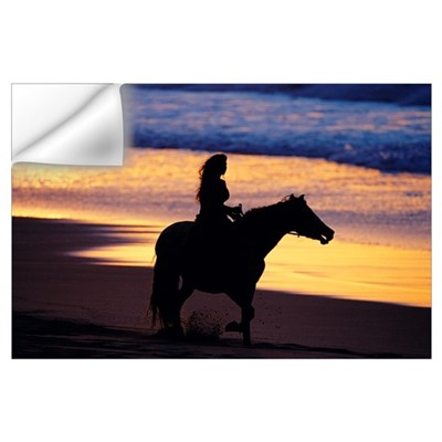 Woman riding a horse on the beach Wall Decal