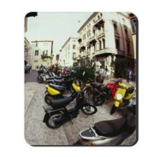 Scooters and motorbikes parked on a stree Mousepad