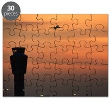Silhouette of aeroplane and control tower a Puzzle
