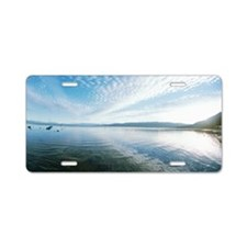 Reflection of clouds on Lak Aluminum License Plate