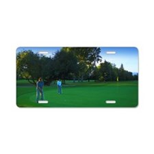 Two golfers on green Aluminum License Plate