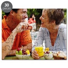 Close-up of a mature couple having breakfas Puzzle