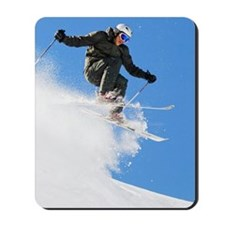 Downhill skier making a jump Mousepad