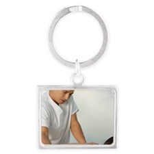 Mature man giving a young woman Landscape Keychain