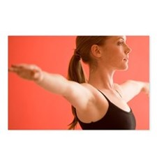 Young woman stretching Postcards (Package of 8)