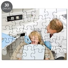 Male dentist examining boy Puzzle