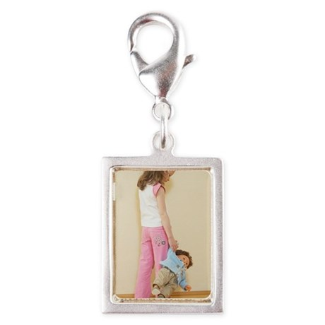 rear view of young girl hold Silver Portrait Charm