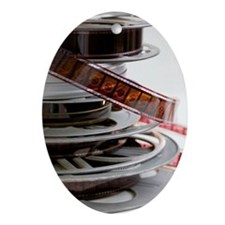 Stack of movie film reels Ornament (Oval)